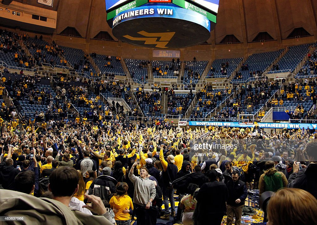 West Virginia Mountaineer students and fans storm the floor after defeating the Kansas Jayhawks 6261 at the WVU Coliseum on February 16 2015 in...