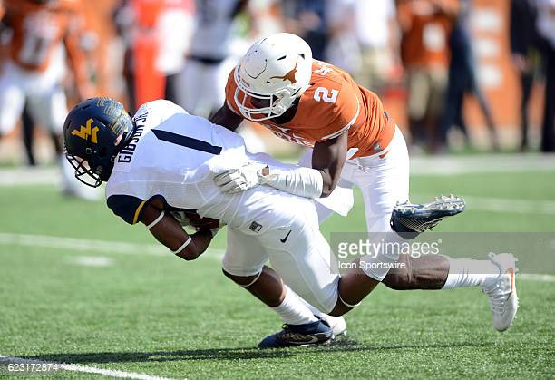 West Virginia Mountaineer WR Shelton Gibson is tackled by Texas Longhorn CB Kris Boyd during NCAA game between the West Virginia Mountaineers and the...