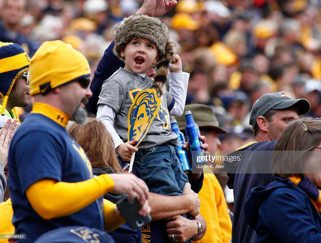 West Virginia Mountaineers fan cheers against the Baylor Bears during the game on October 18 2014 at Mountaineer Field in Morgantown West Virginia