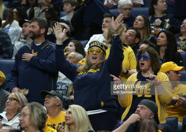 West Virginia Mountaineers fans cheer during the NCAA Division 1 Men's Basketball Championship game between Notre Dame Fighting Irish and West...