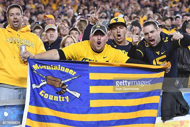 West Virginia Mountaineers fans hold a flag during an NCAA football game between the Kansas Jayhawks and the West Virginia Mountaineers on November 5...