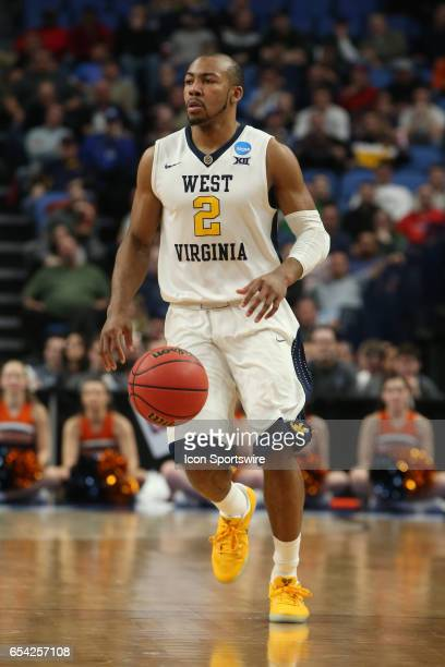 West Virginia Mountaineers guard Jevon Carter dribbles up the court during the NCAA Division I Men's Basketball Championship first round game between...