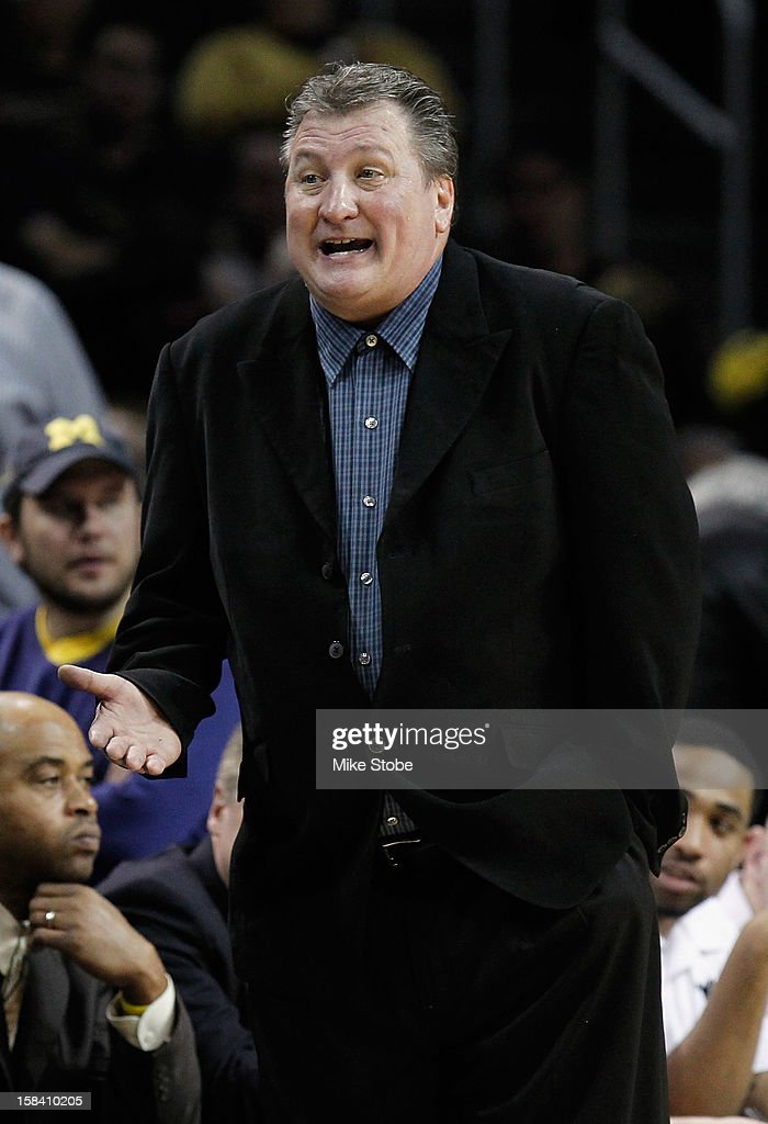 West Virginia Mountaineers Head coach <a gi-track='captionPersonalityLinkClicked' href=/galleries/search?phrase=Bob+Huggins&family=editorial&specificpeople=2230174 ng-click='$event.stopPropagation()'>Bob Huggins</a> reacts during the game against the West Virginia Mountaineers during the Brooklyn Hoops Winter Festival on December 15, 2012 at Barclays Center in the Brooklyn borough of New York City.