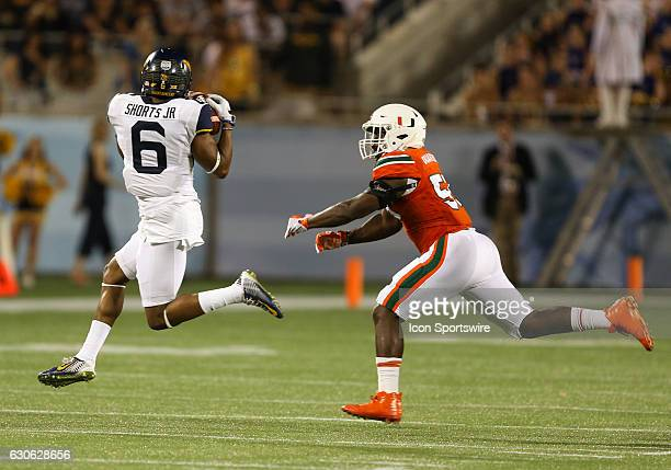 West Virginia Mountaineers wide receiver Daikiel Shorts catches a pass during the Russell Athletic Bowl game between the West Virginia Mountaineers...