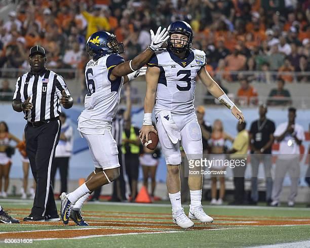 West Virginia University Mountaineers quarterback Skyler Howard celebrates his touchdown run with West Virginia University Mountaineers wide receiver...