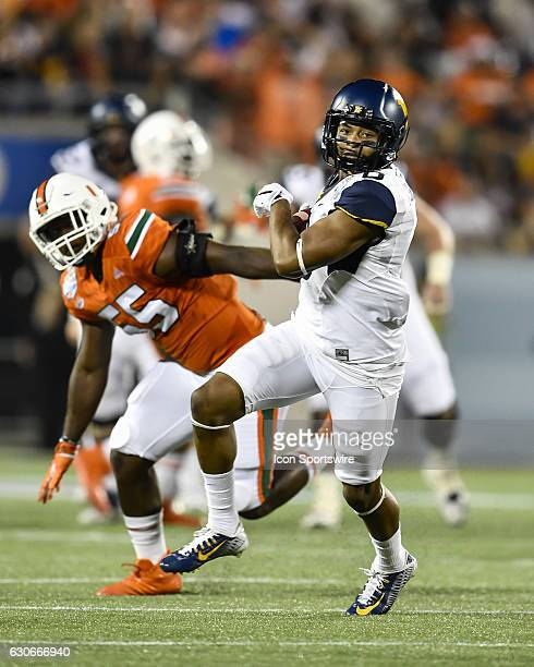 West Virginia University Mountaineers wide receiver Daikiel Shorts Jr runs up field after a reception during the first half of the Russell Athletic...