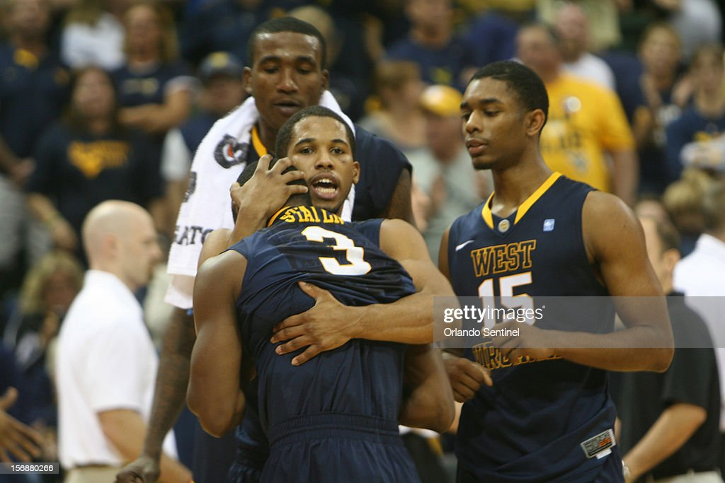 West Virginia's Juwan Staten (3) is consoled by teammate Gary Browne while fellow Mountaineers Aaric Murray and Terry Henderson (15) look on after Staten missed a last-second 3-pointer in a 63-60 loss to Davidson in the Old Spice Classic semifinals at the HP Field House in Lake Buena Vista, Florida, on Friday, November 23, 2012.