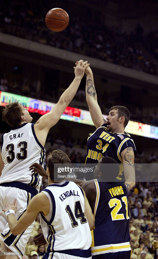 West Virginia's Kevin Pittsnogle has his shot partially blocked by Pittsburgh Panthers Aaron Gray during action at the Petersen Events Center on...