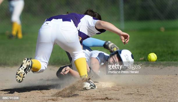 Westbrook's Cam LaPierre dives back to second base as Isabella Santoro covers the bag for Cheverus Friday May 19 2017