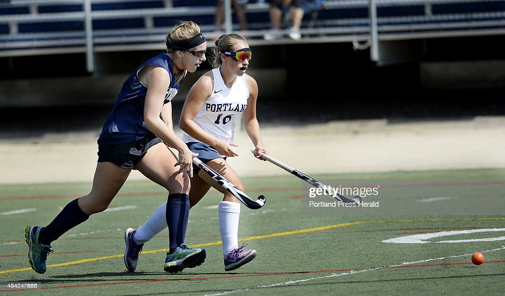 Westbrook's Camryn LaPierre chases down the ball with Portland's Taylor Sargent during the SMMA field hockey play day in Portland Tuesday August 26, 2014.