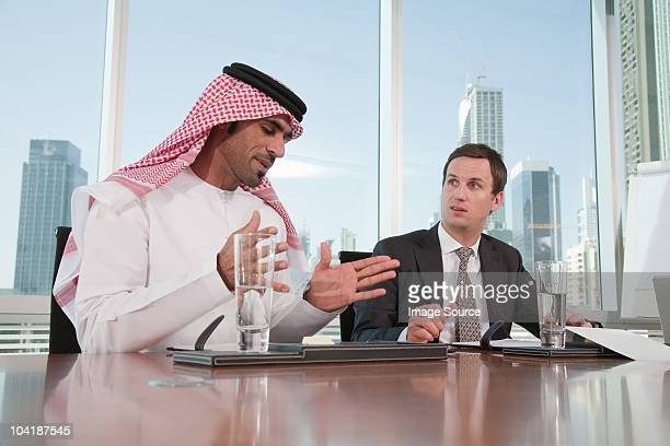 Western and middle eastern businessmen in meeting