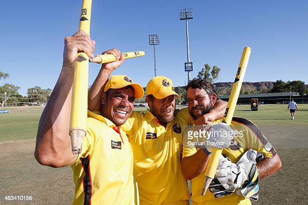 Western Australia players and brothers Keren Dane and Liam Ugle celebrate after winning the 2015 Imparja Cup on February 14 2015 in Alice Springs...
