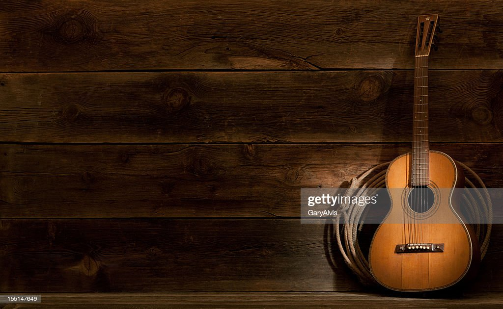 Western barnwood background w/parlor guitar & lasso : Stock Photo