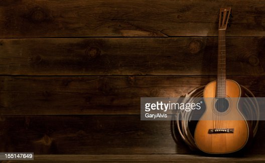 Western barnwood background w/parlor guitar & lasso