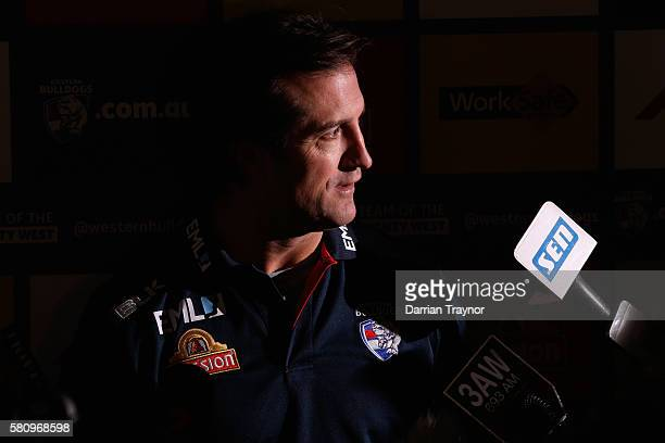 Western Bulldoags coach Luke Beveridge speaks to the media before a Western Bulldogs AFL training session at Whitten Oval on July 26 2016 in...