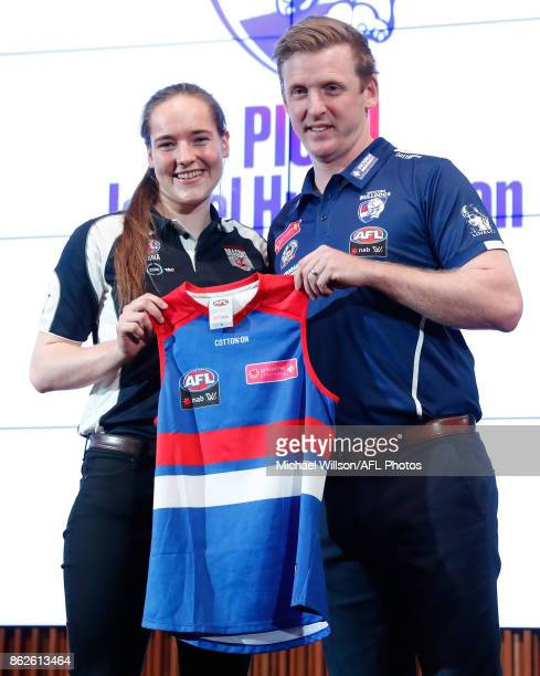 Western Bulldogs Coach Paul Groves poses for a photo with AFLW number 1 draft pick Isabel Huntington during the 2017 NAB AFL Women's Draft at...