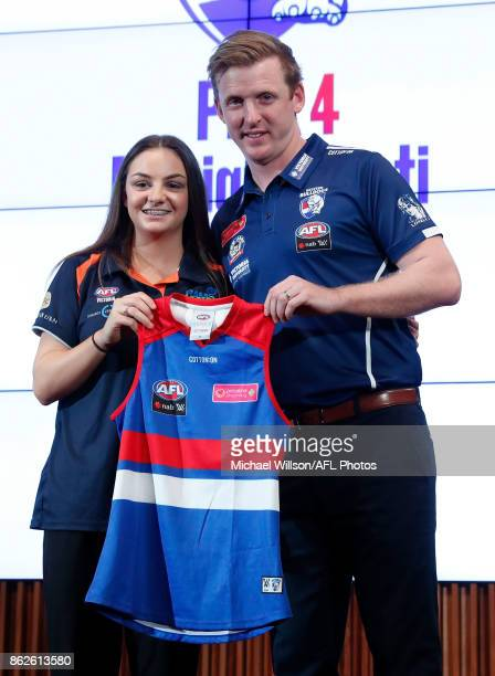 Western Bulldogs Coach Paul Groves poses for a photo with Monique Conti during the 2017 NAB AFL Women's Draft at Docklands on October 18 2017 in...