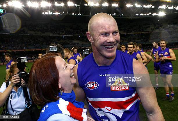 Western Bulldogs forward Barry Hall and Prime Minister Julia Gillard celebrate after the clubs win in the round 18 AFL match between the Western...