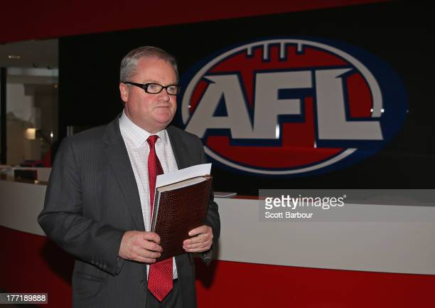 Western Bulldogs president Peter Gordon leaves after attending a special meeting of all 18 AFL Club Presidents at AFL House on August 22 2013 in...
