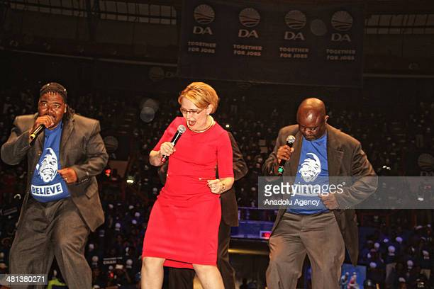 Western Cape Premier Helen Zille the leader of the Democratic Alliance sings and dances on the stage with local singers during the DA's election...