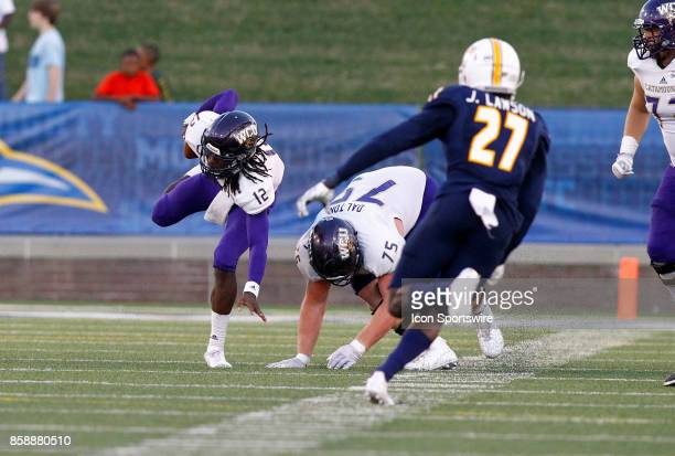 Western Carolina Catamounts quarterback Tyrie Adams maintains his balance on a run from the pocket The Western Carolina Catamounts defeated the...