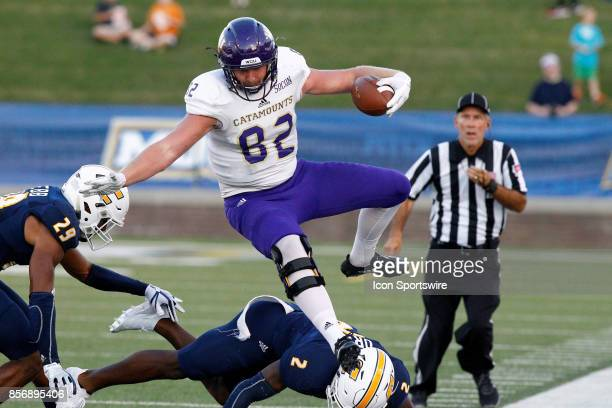 Western Carolina Catamounts tight end Tyler Sexton hurdles Chattanooga Mocs Kareem Orr but lands out of bounds The Western Carolina Catamounts...