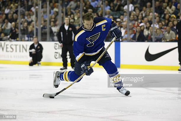Western competitor Al MacInnis of the St Louis Blues fires off a 989 mph shot in the Hardest Shot event during the Dodge SuperSkills competition part...