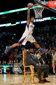 Western Conference AllStar Ben McLemore of the Sacramento Kings dunks the ball over Shaquille O'Neal during the Sprite Slam Dunk Contest 2014 as part...