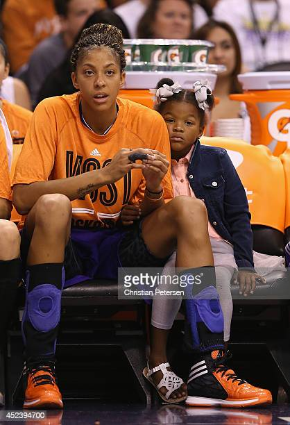 Western Conference AllStar Candace Parker of the Los Angeles Sparks sits with her daugher Lailaa on the bench during the WNBA AllStar Game at US...
