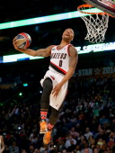 Western Conference AllStar Damian Lillard of the Portland Trail Blazers competes in the Sprite Slam Dunk Contest 2014 as part of the 2014 NBA AllStar...