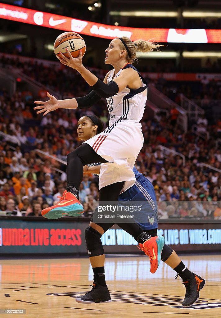 Western Conference AllStar Katie Douglas of the Connecticut Sun lays up a shot during the WNBA AllStar Game at US Airways Center on July 19 2014 in...