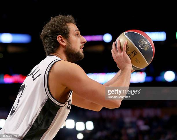 Western Conference AllStar Marco Belinelli of the San Antonio Spurs competes in the Foot Locker ThreePoint Contest 2014 as part of the 2014 NBA...