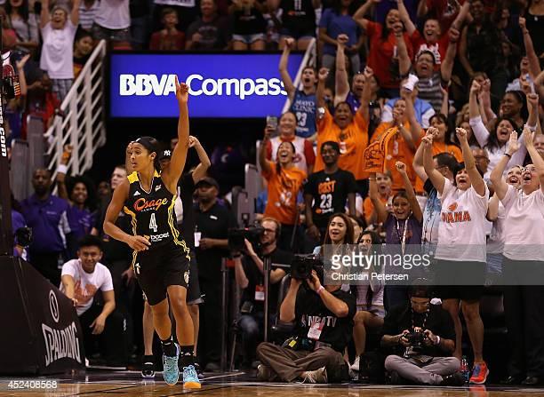 Western Conference AllStar Skylar Diggins of the Tulsa Shock celebrates after scoring against the Eastern Conference AllStars during the WNBA AllStar...