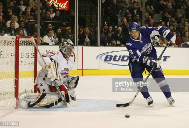 Western Conference AllStar Teemu Selanne of the Anaheim Ducks receives a pass near Eastern Conference AllStar goaltender Ryan Miller of the Buffalo...
