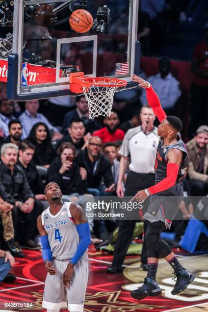 Western Conference guard Russell Westbrook misses a dunk against Eastern Conference forward Paul Millsap during the NBA AllStar Game between the...