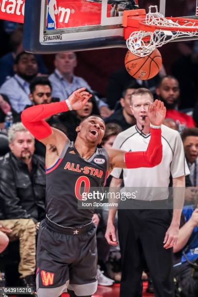 Western Conference guard Russell Westbrook reacts to dunking the ball against the Eastern Conference during the NBA AllStar Game between the Eastern...