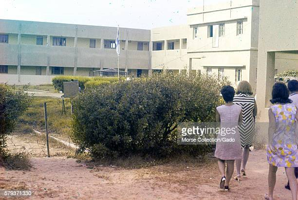 Western female tourists walking through a courtyard between buildings in the town of El Arish located in the northern Sinai peninsula in Gaza Israel...