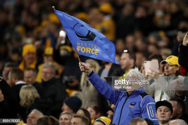 Western Force supporter waves a flag during The Rugby Championship Bledisloe Cup match between the Australian Wallabies and the New Zealand All...