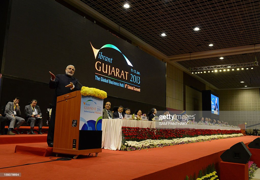 Western India's Gujarat state Chief Minister Narendra Modi (L) addresses the audience during the Velidictory function of the Vibrant Gujarat 2013 6th Global Summit at Mahatma Mandir in Gandhinagar, some 30 kms from Ahmedabad on January 12, 2013. The summit was inaugurated by Gujarat Chief Minister, Narendra Modi yesterday and the two day summit is attended by a wide range of national and international corporate representatives. AFP PHOTO / Sam PANTHAKY