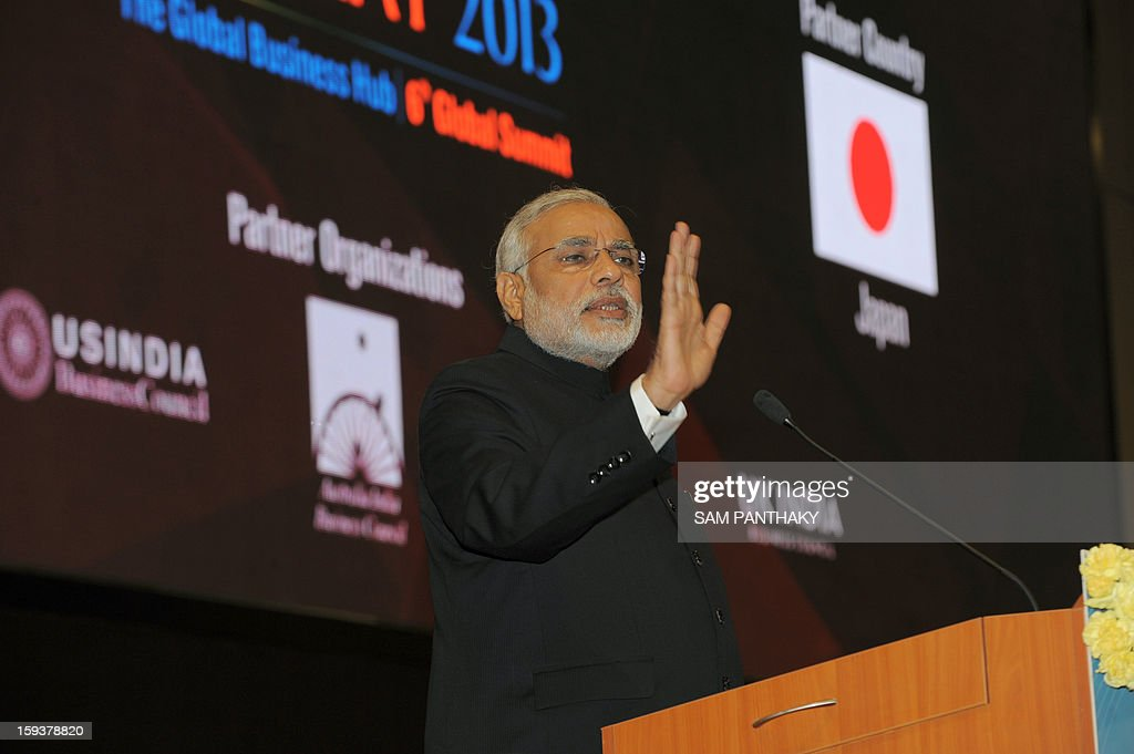 Western India's Gujarat state Chief Minister Narendra Modi addresses the audience during the Velidictory function of the Vibrant Gujarat 2013 6th Global Summit at Mahatma Mandir in Gandhinagar, some 30 kms from Ahmedabad on January 12, 2013. The summit was inaugurated by Gujarat Chief Minister, Narendra Modi on January 11 and the two day summit is attended by a wide range of national and international corporate representatives. AFP PHOTO / Sam PANTHAKY