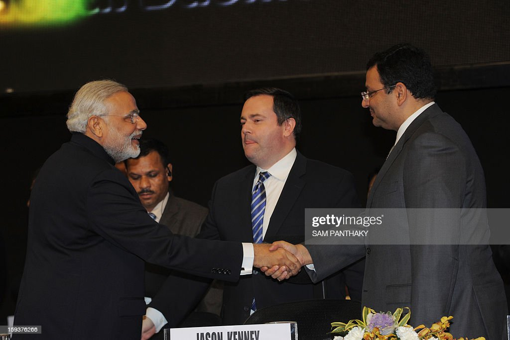 Western India's Gujarat state Chief Minister Narendra Modi (L) greets New Tata Group Chairman Cyrus Mistry (R) and Canadian Immigration Minister Jason Kenney (C) during the Velidictory function of the Vibrant Gujarat 2013 6th Global Summit at Mahatma Mandir in Gandhinagar, some 30 kms from Ahmedabad on January 12, 2013. The summit was inaugurated by Gujarat Chief Minister, Narendra Modi yesterday and the two day summit is attended by a wide range of national and international corporate representatives. AFP PHOTO / Sam PANTHAKY