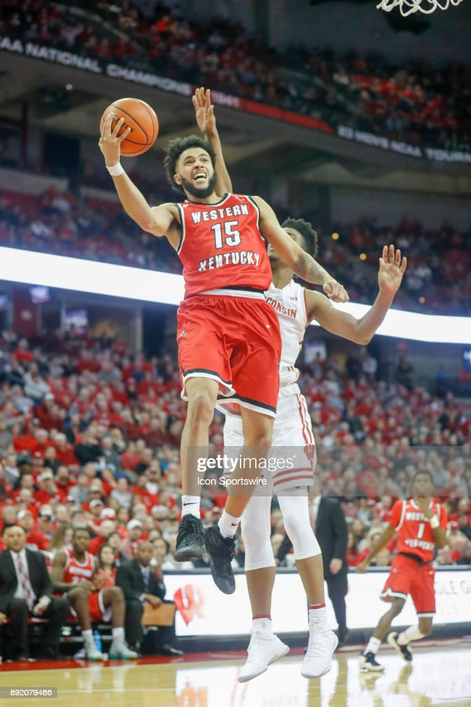 Western Kentucky guard Darius Thompson (15) goes up for a score in front of Wisconsin forward Aleem Ford (2) during a college basketball game between the University of Wisconsin Badgers and the Western Kentucky University Hilltoppers on December 13, 2017 at the Kohl Center in Madison, WI.