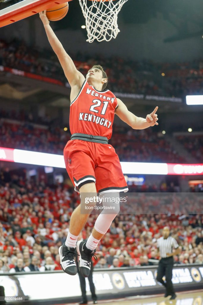 Western Kentucky guard Jake Ohmer (21) has an easy layup during a college basketball game between the University of Wisconsin Badgers and the Western Kentucky University Hilltoppers on December 13, 2017 at the Kohl Center in Madison, WI.