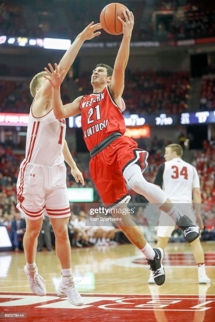 Western Kentucky guard Jake Ohmer (21) scores over Wisconsin guard Brevin Pritzl(1) during a college basketball game between the University of Wisconsin Badgers and the Western Kentucky University Hilltoppers on December 13, 2017 at the Kohl Center in Madison, WI.
