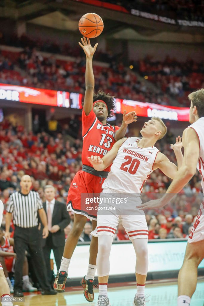 Western Kentucky guard Taveion Hollingsworth (13) attempts a shot over Wisconsin guard T.J. Schlundt (20) during a college basketball game between the University of Wisconsin Badgers and the Western Kentucky University Hilltoppers on December 13, 2017 at the Kohl Center in Madison, WI.