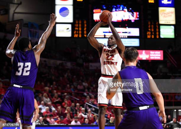 Western Kentucky Hilltoppers forward Dwight Colby takes a shot over Kentucky Wesleyan Panthers forward Amir Warnock during the first half of a...