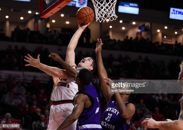Western Kentucky Hilltoppers forward Justin Johnson puts back his own shot over Kentucky Wesleyan Panthers guard Harold Cardwell and Kentucky...