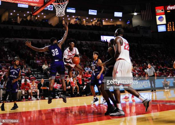 Western Kentucky Hilltoppers guard Taveion Hollingsworth goes under the arms of Kentucky Wesleyan Panthers forward Amir Warnock during the second...