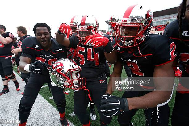 Western Kentucky Hilltoppers players celebrate after the game against the Marshall Thundering Herd at LT Smith Stadium on November 27 2015 in Bowling...