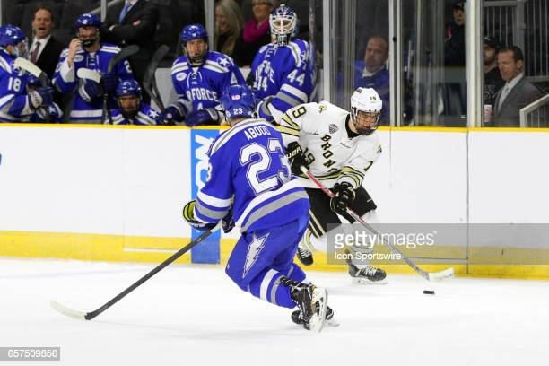 Western Michigan Broncos forward Frederik Tiffels and Air Force Falcons defenseman Dylan Abood in action during the first period of the NCAA East...